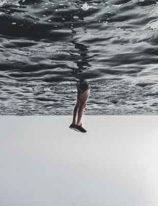 person diving on body of water